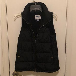 Black puffer vest.